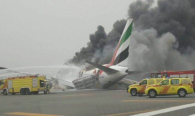 Smoke billowing from an Emirates plane that caught fire at Dubai Airport.